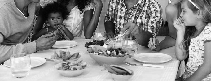 Black and White Famalies having a dinner together